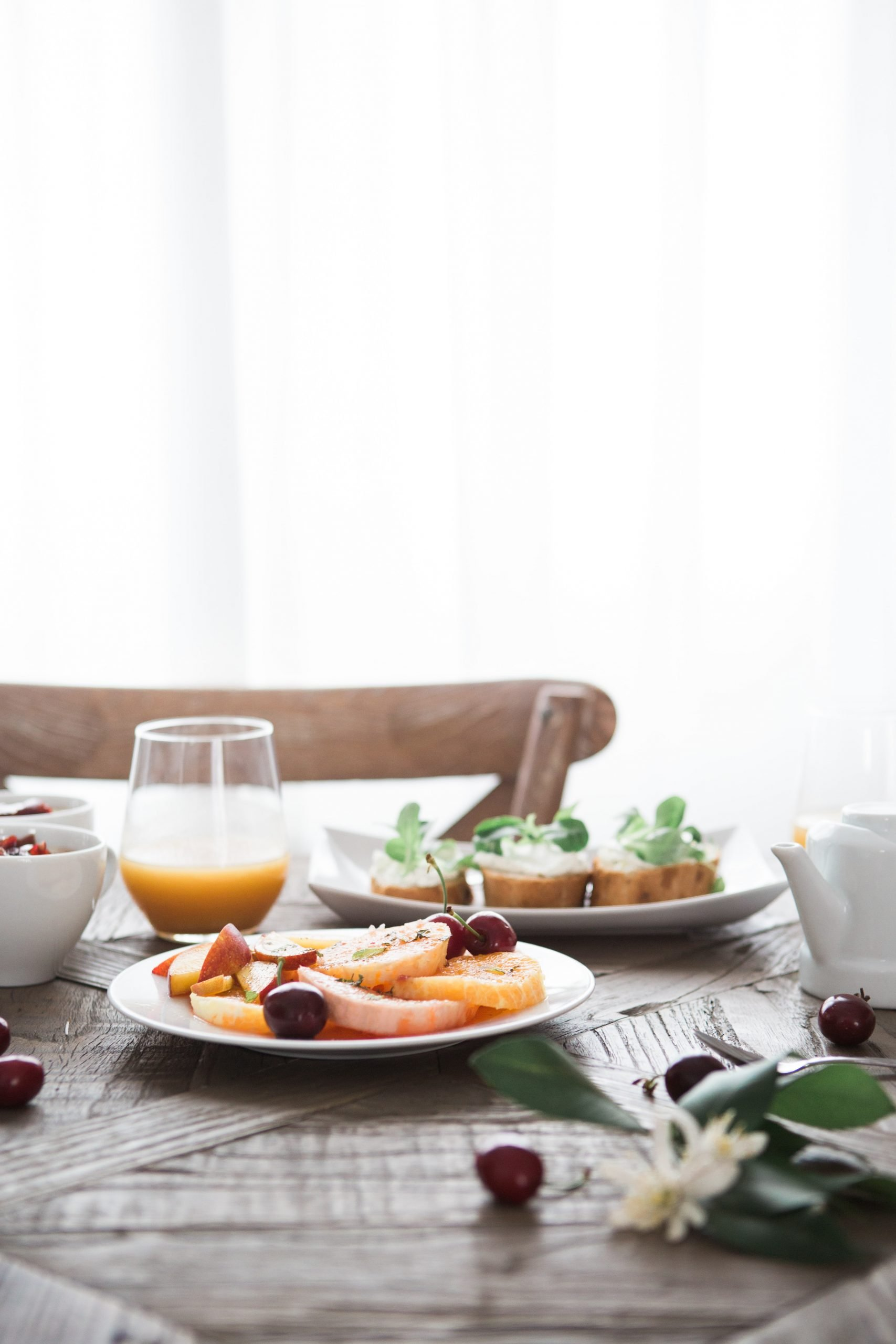 table setting with fruit and toast and juice